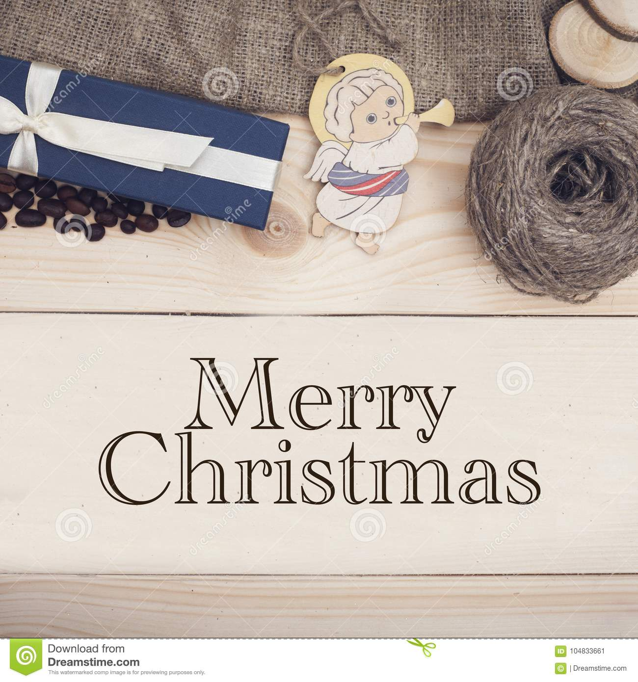 Merry Christmas inscription on a wooden background