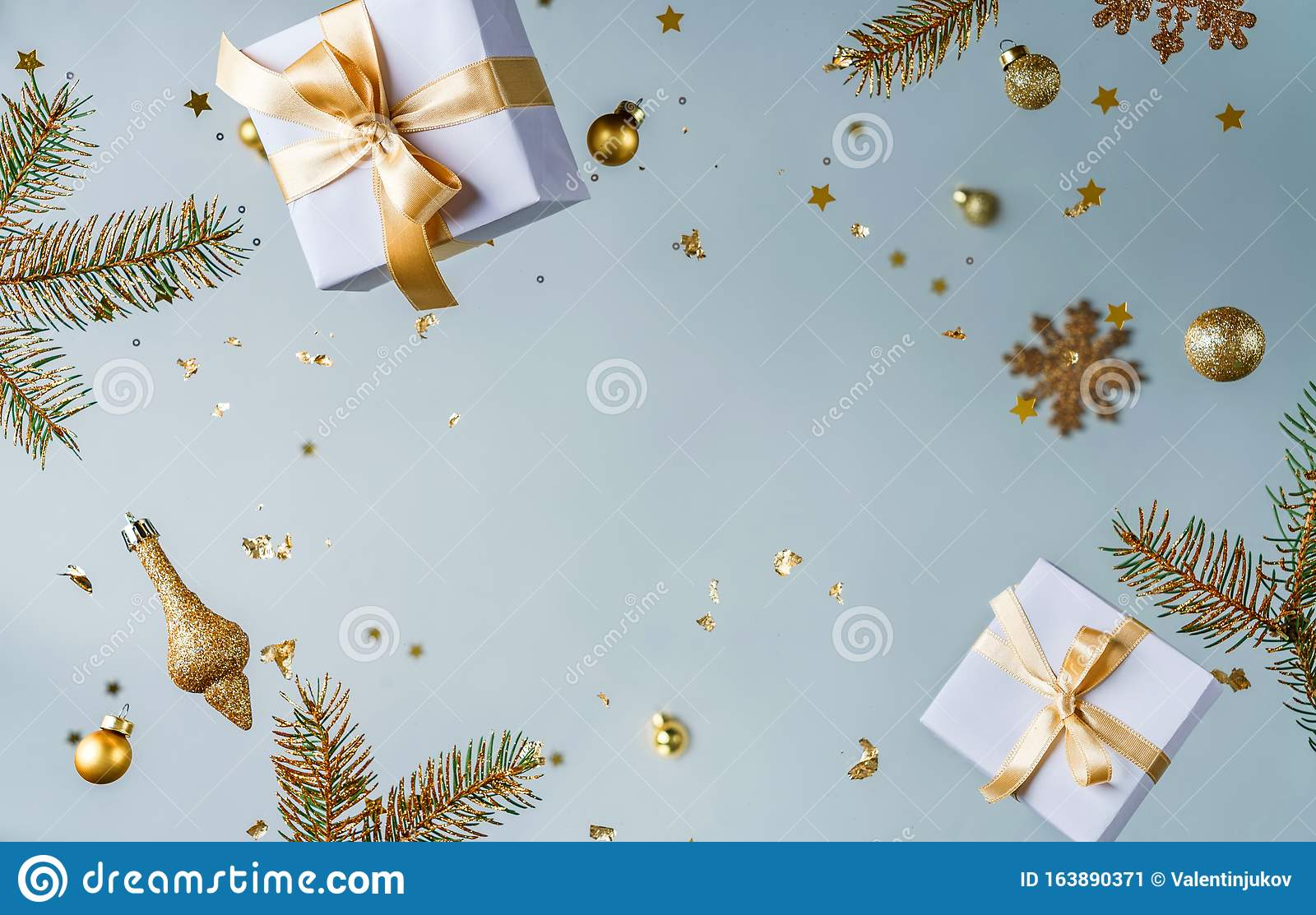 Merry Christmas and New Year background. Xmas holiday card made of flying decorations, gold fir branches, balls, snowflakes