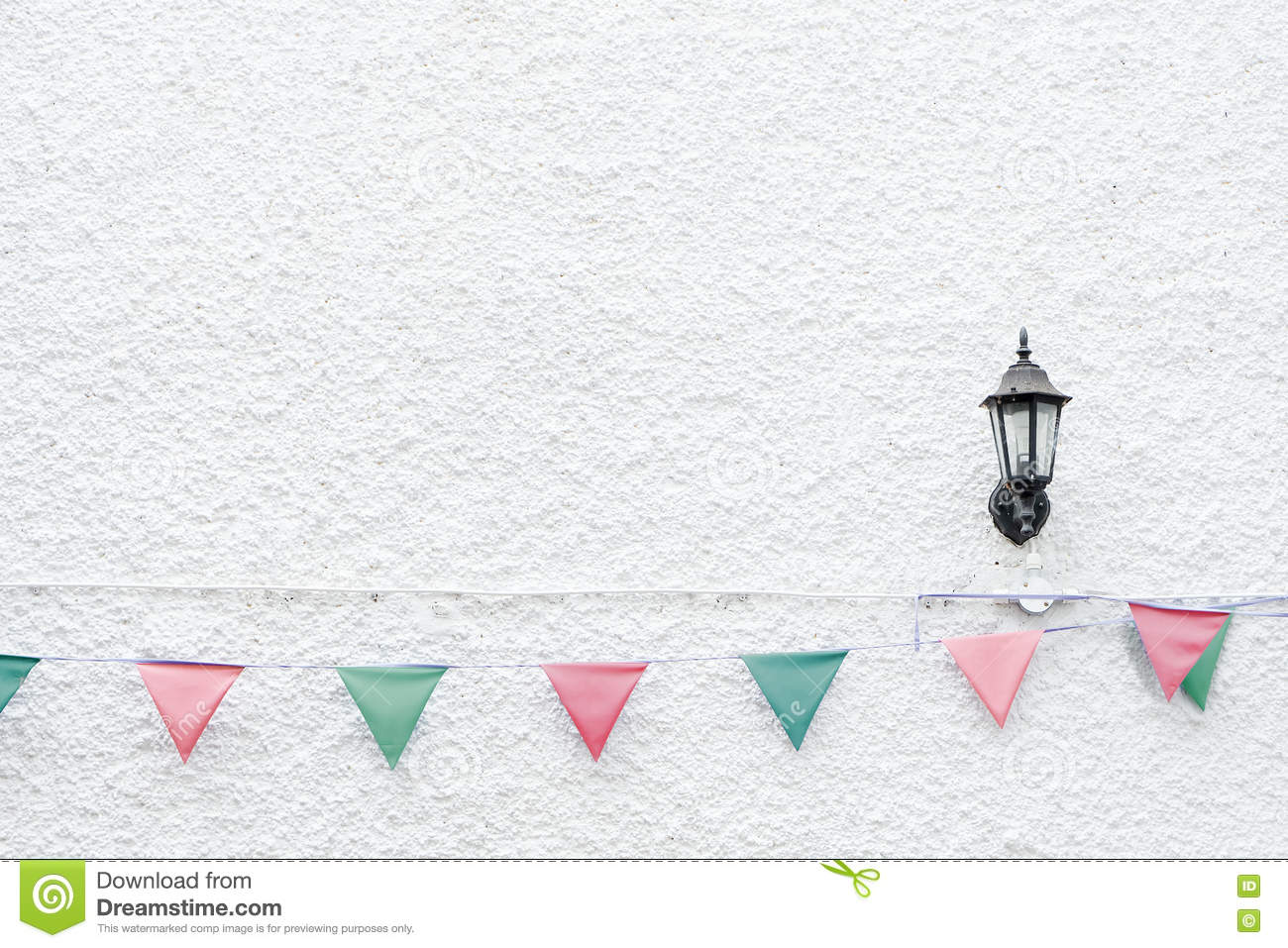 Merry Christmas Party flags bunting hanging on white wall background on x`mas eve holiday event. Minimal hipster style design.
