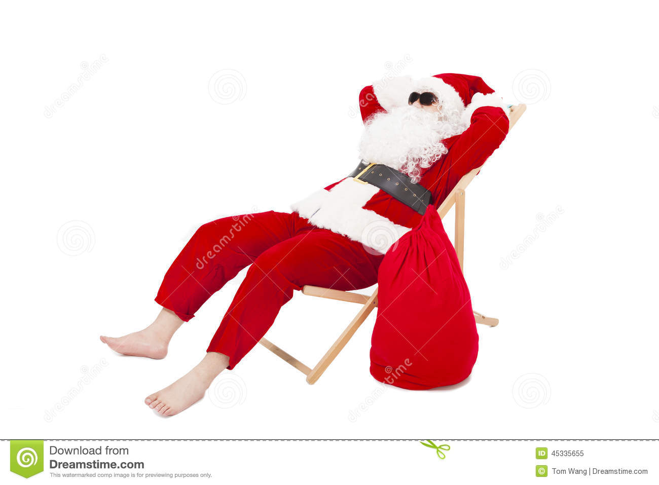Merry Christmas Santa Claus Sitting A Chair With Gift Bag Stock Image