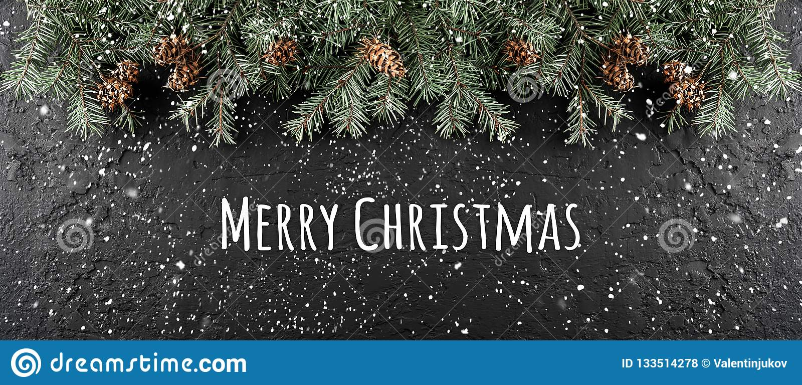 Merry Christmas Typographical on dark holiday background with frame of Fir branches, pine cones