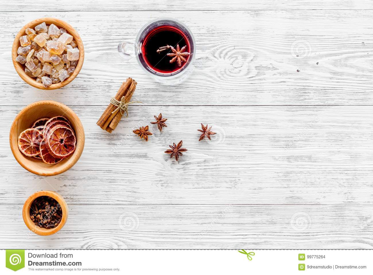 Merry christmas in winter evening with warm drink. Hot mulled wine or grog with fruits and spices on light background