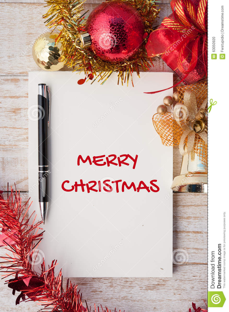 Merry Christmas Word On Notebook And Christmas Gift Box With Dec