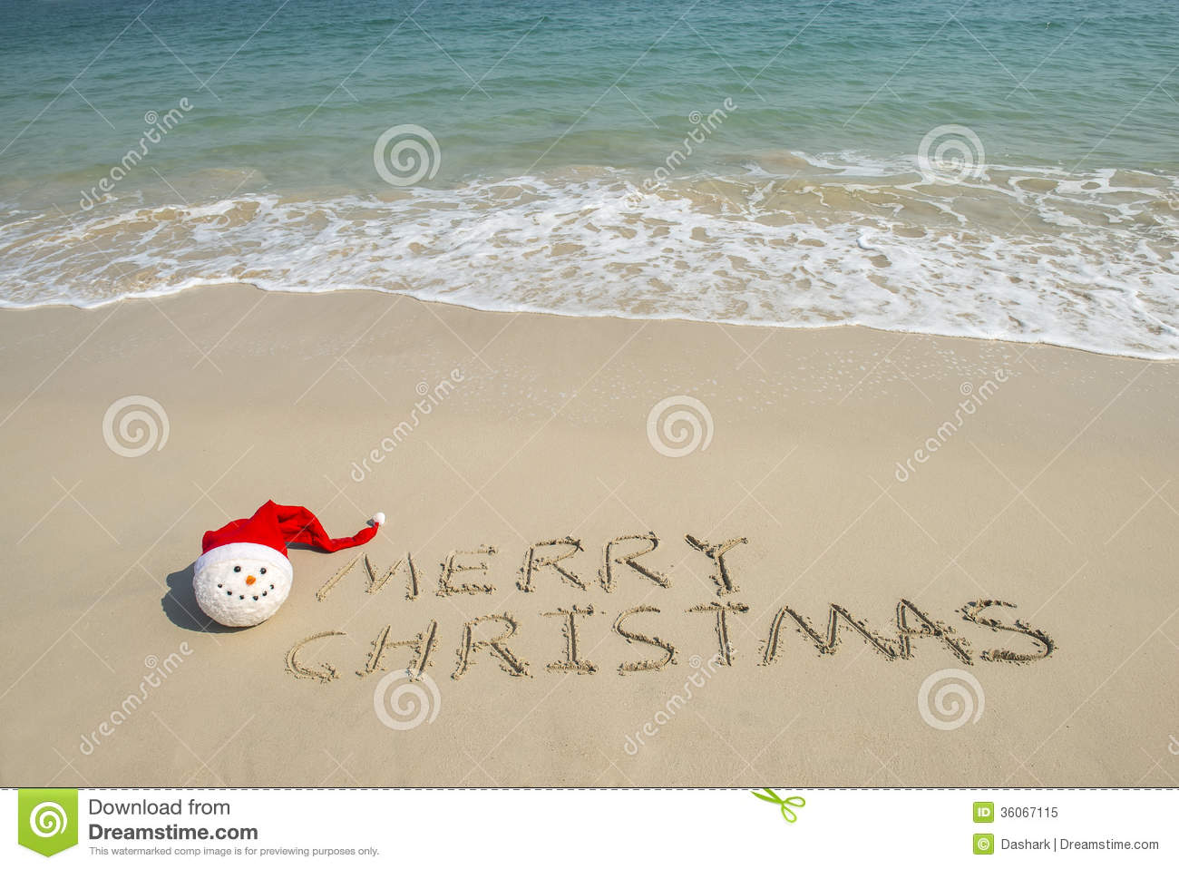 merry christmas written on tropical beach white sand with snowman - Merry Christmas Beach Images