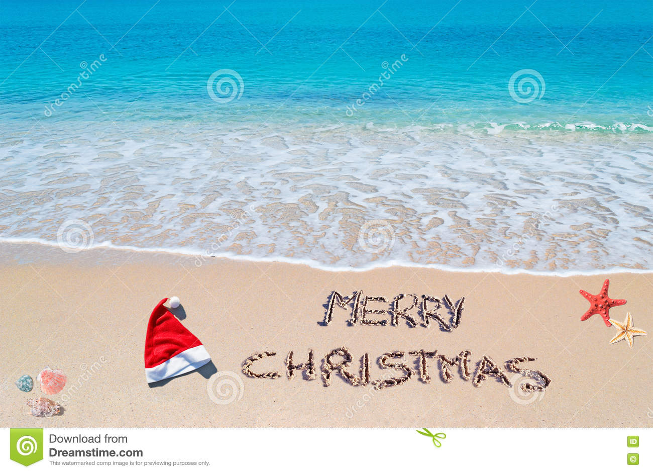 901d139720dce Santa hat and`merry christmas` written on a tropical beach