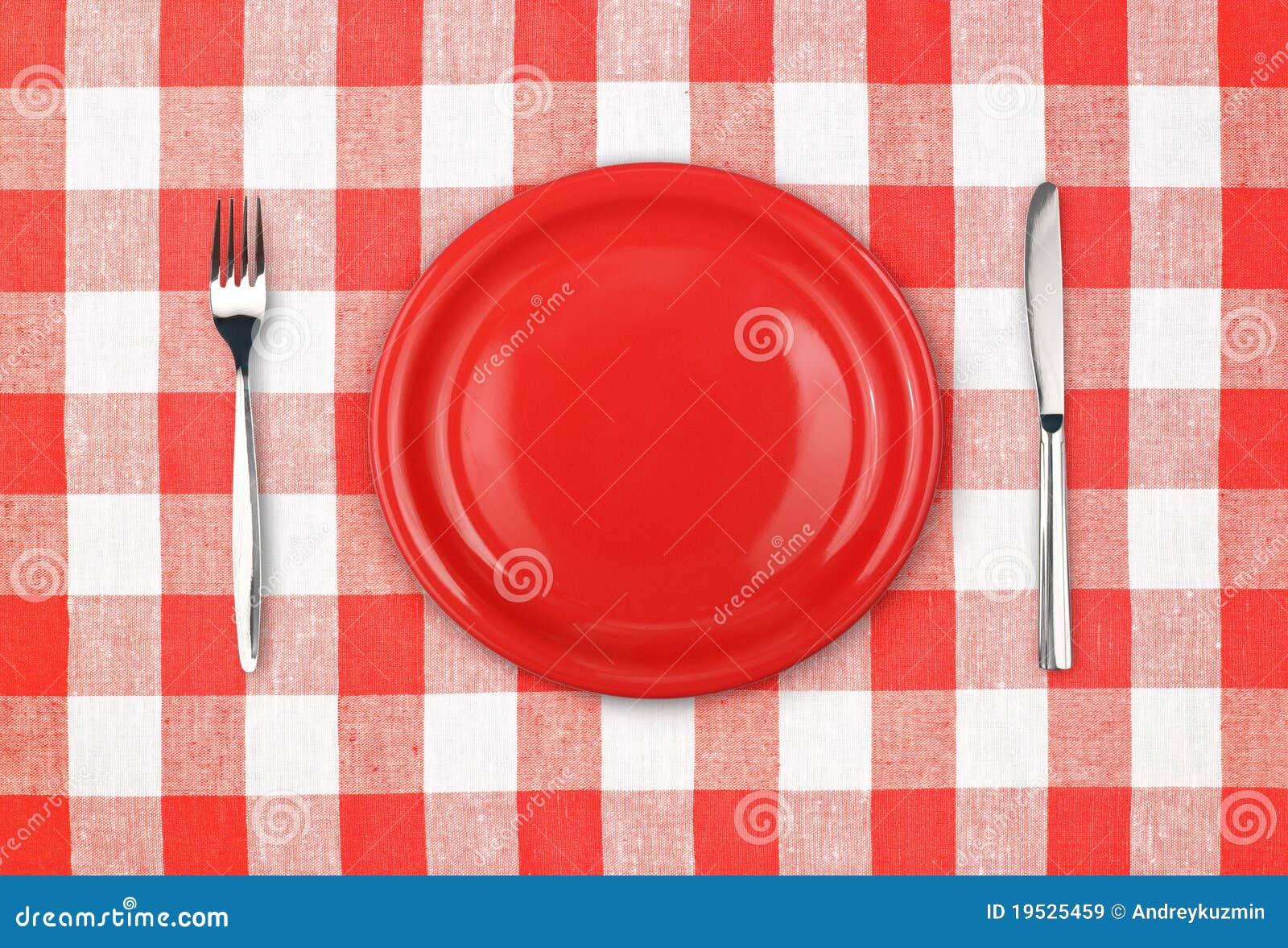 Mes rode plaat en vork op gecontroleerd tafelkleed royalty vrije stock afbeeldingen - Aardewerk rode keuken ...
