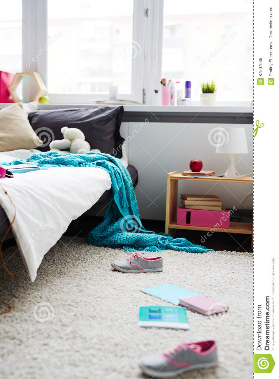 Modern Messy Bedroom Of Teenage Girl With Sneakers Copybooks Scattered On Carpet And Blanket Hanging Down From Bed