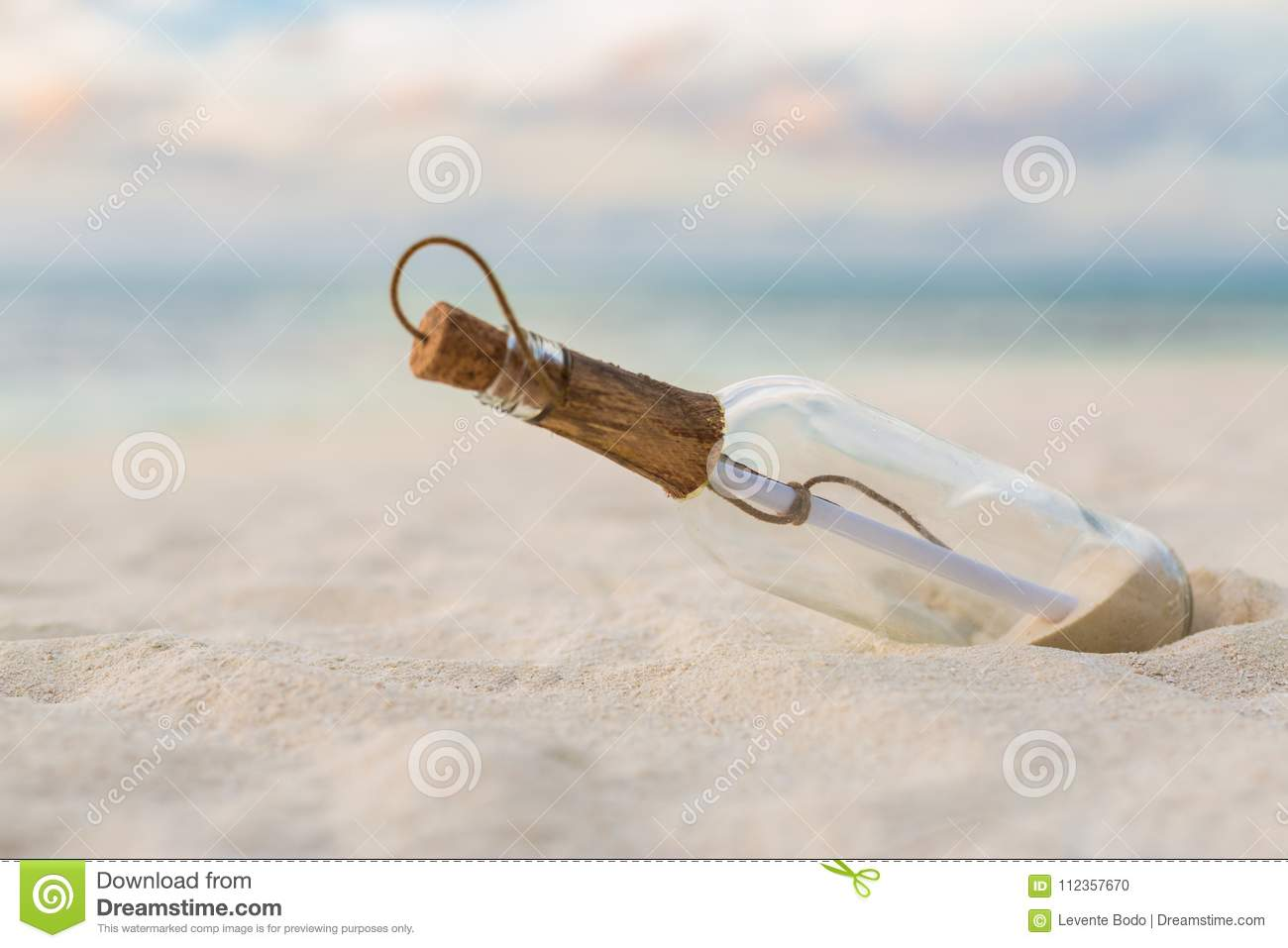 Message in a bottle on a tropical beach and blurred background. Inspire bckground design