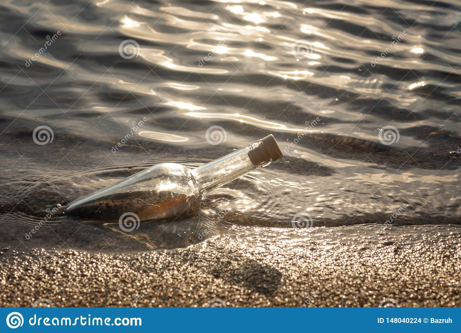 Message in a corked bottle on shore, hope of salvation