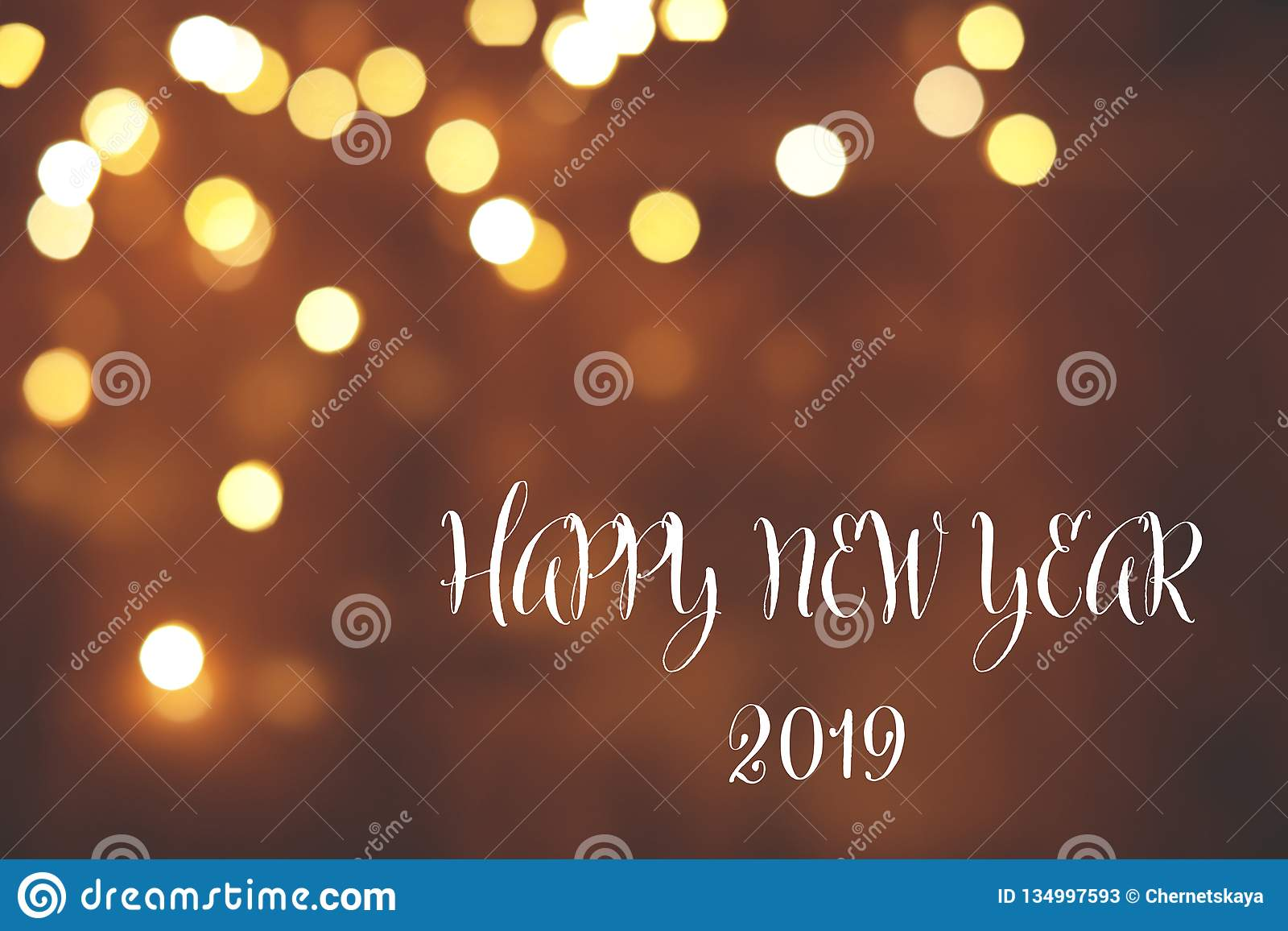 Message HAPPY NEW YEAR 2019 and bokeh effect on background, space for text.