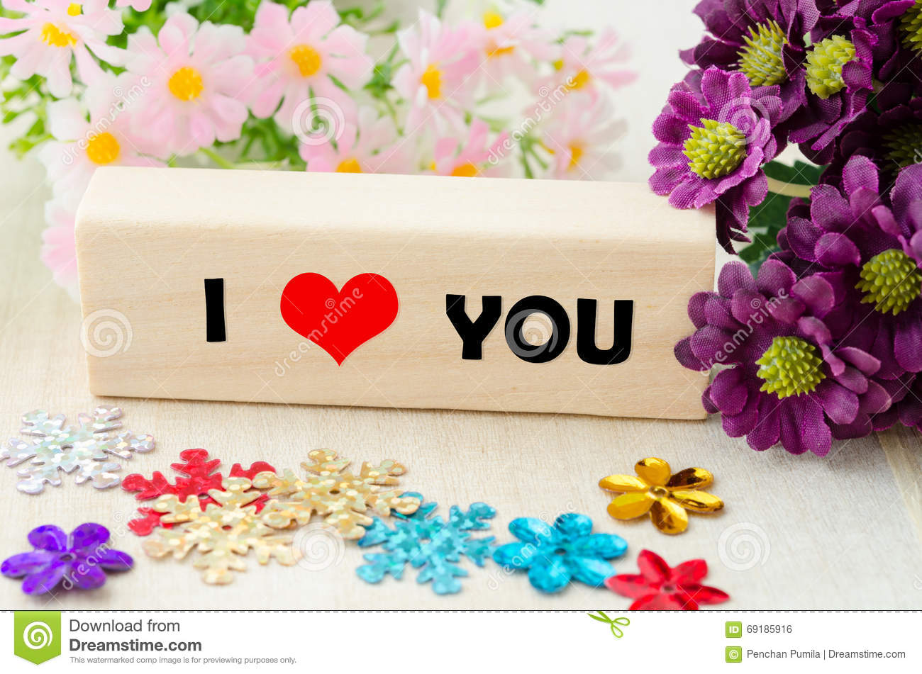 Message I Love You Spelled In Wooden Blocks With Flower Stock Photo