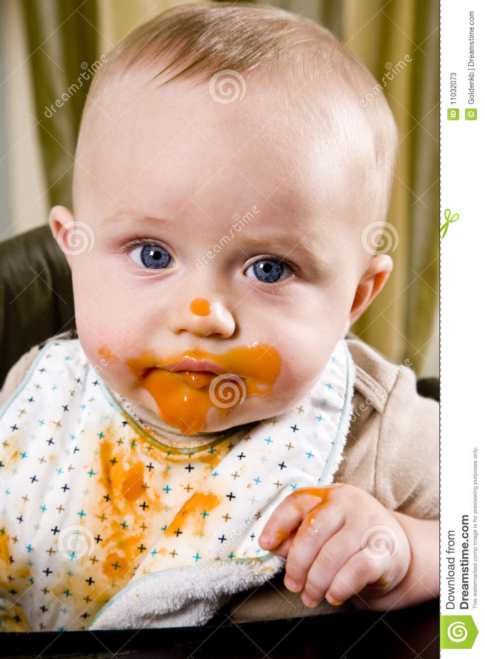 Messy Baby Wearing Bib After Eating Solid Food Stock