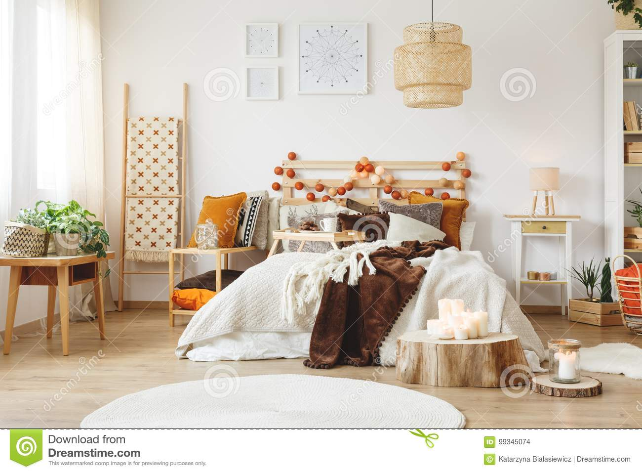 Messy bed in bedroom stock photo. Image of beige, apartment - 99345074