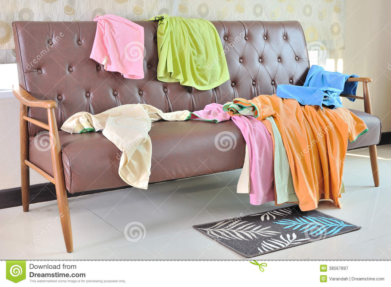 Messy Clothes Scattered On A Sofa In Room Stock Image Image Of