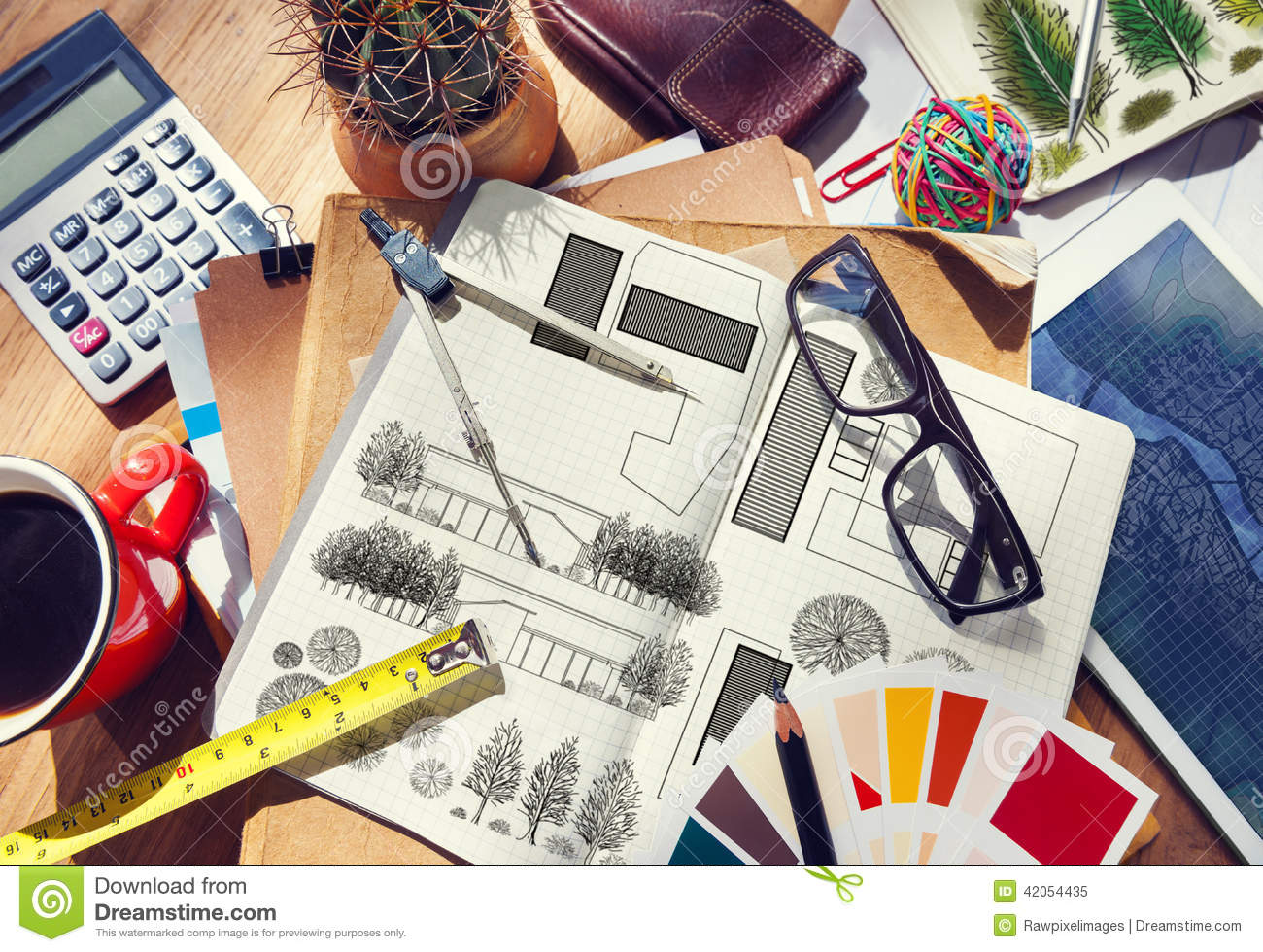 Messy designer 39 s table with project plan and tools stock for Table design tool