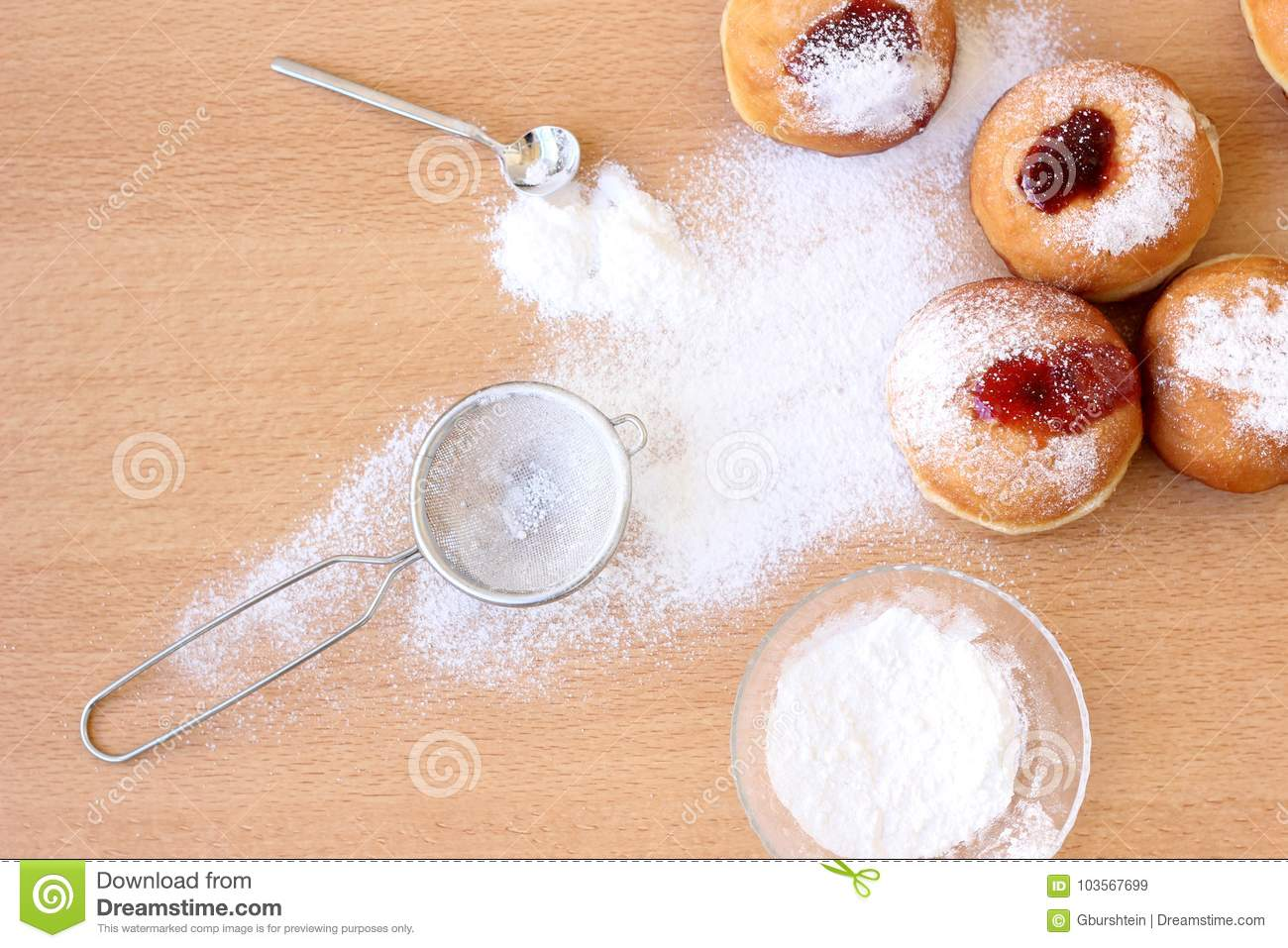 Messy Hanukkah table with sugar powder and doughnuts