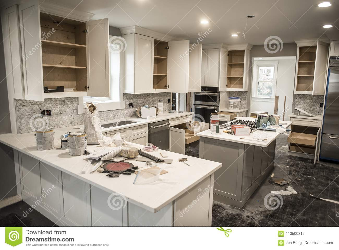 Messy home kitchen during remodeling with cabinet doors open download comp mozeypictures Image collections