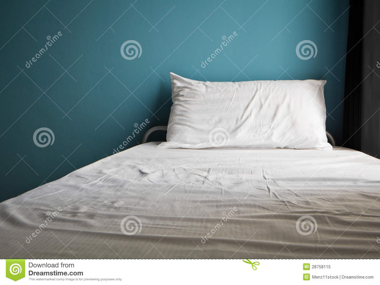 Messy white bed and one pillow light blue wall royalty for Wall pillow for bed