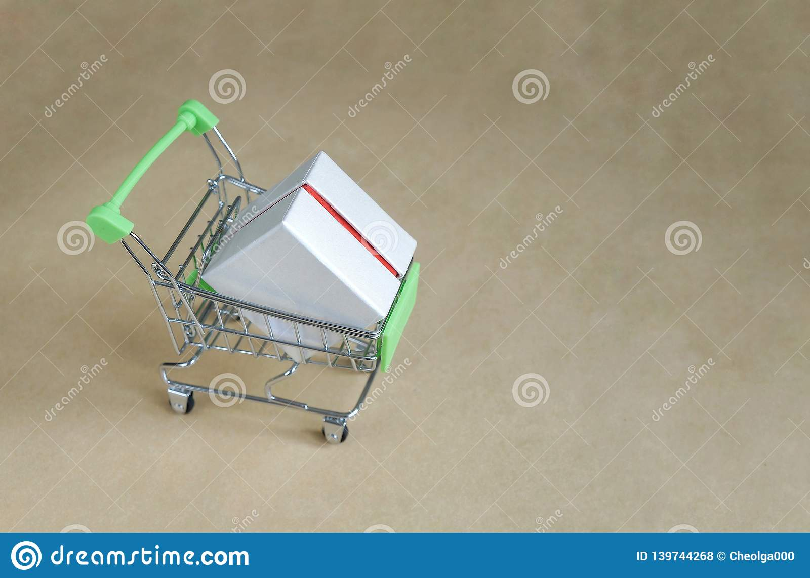 Metal basket with a box of purchase