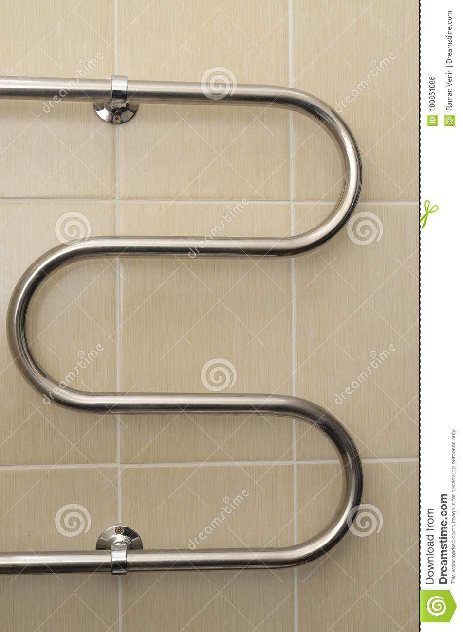 Metal Curved Coil In The Bathroom With Ceramic Tiles Stock Photo