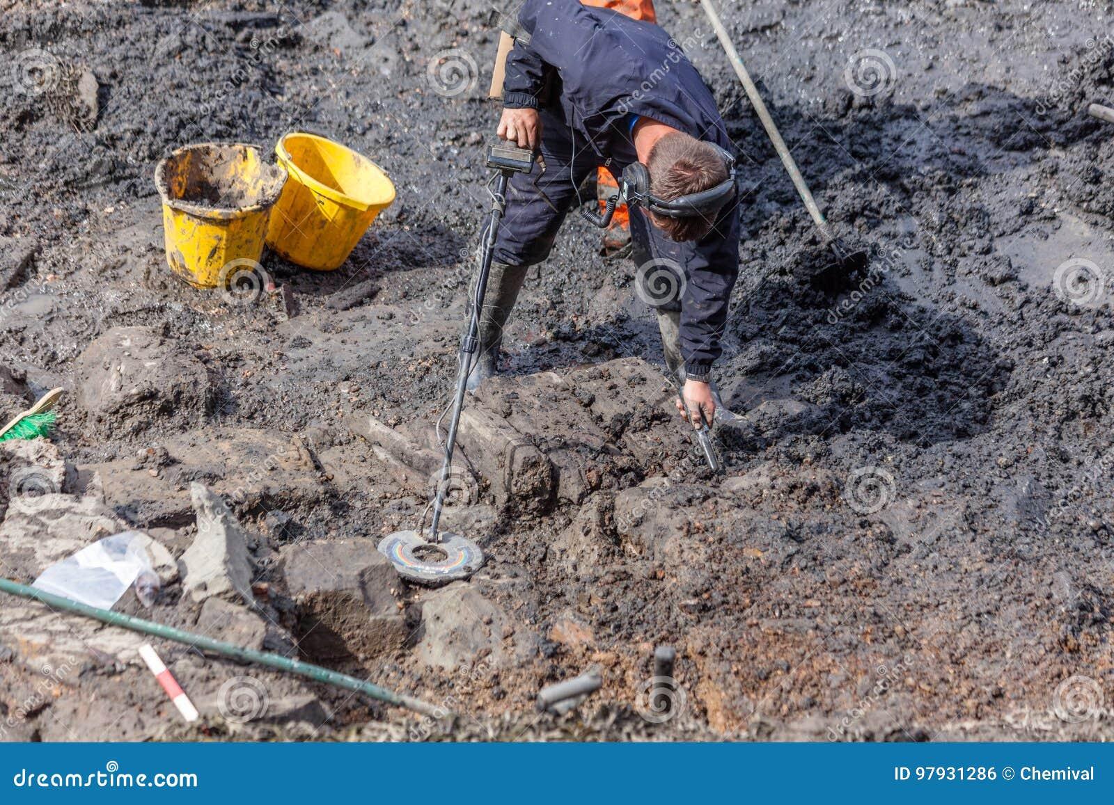 Metal Detectorist at Archaeological Dig