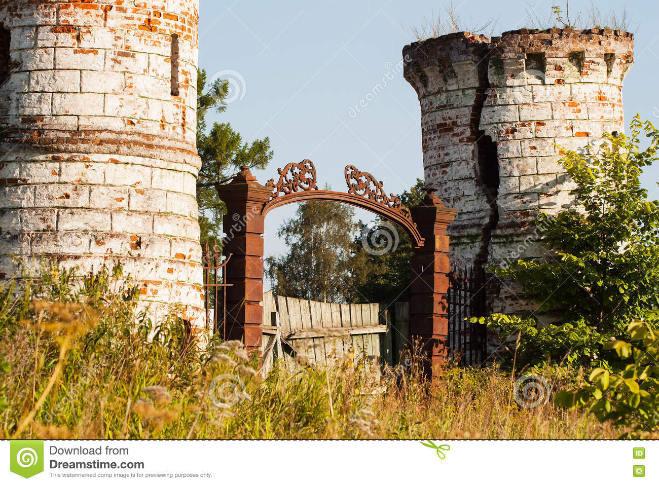 entrance ... & Metal Doors And Dilapidated Towers Of Old Castle Stock Photo ... Pezcame.Com