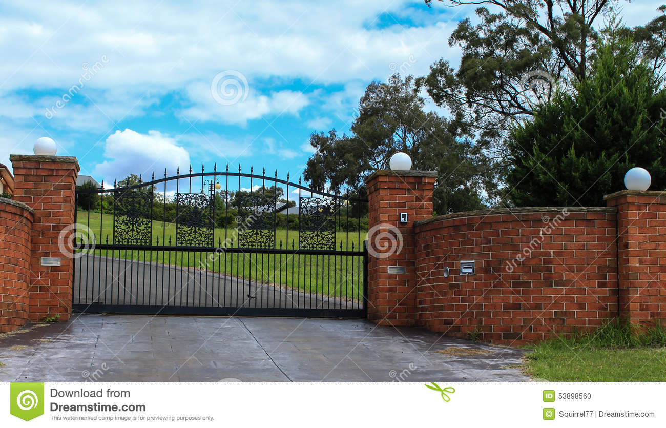 Metal Driveway Entrance Gate Set In Brick Fence Stock