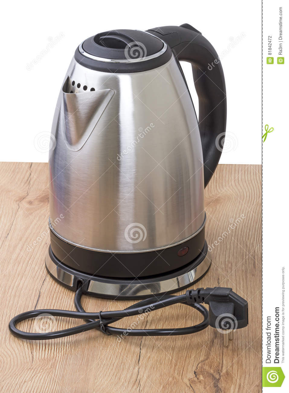 Metal electric kettle on the table