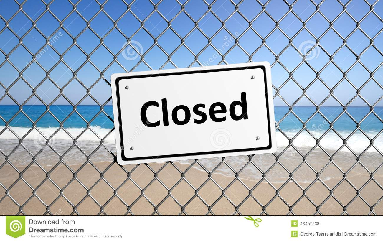 Metal fence with sign Closed