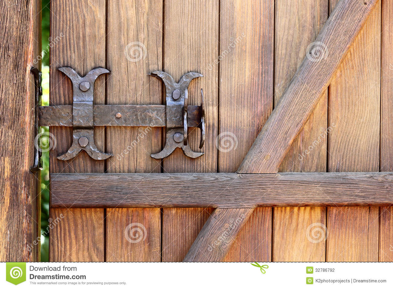 Metal Forged Bolt Lock On A Wooden Door Stock Photo