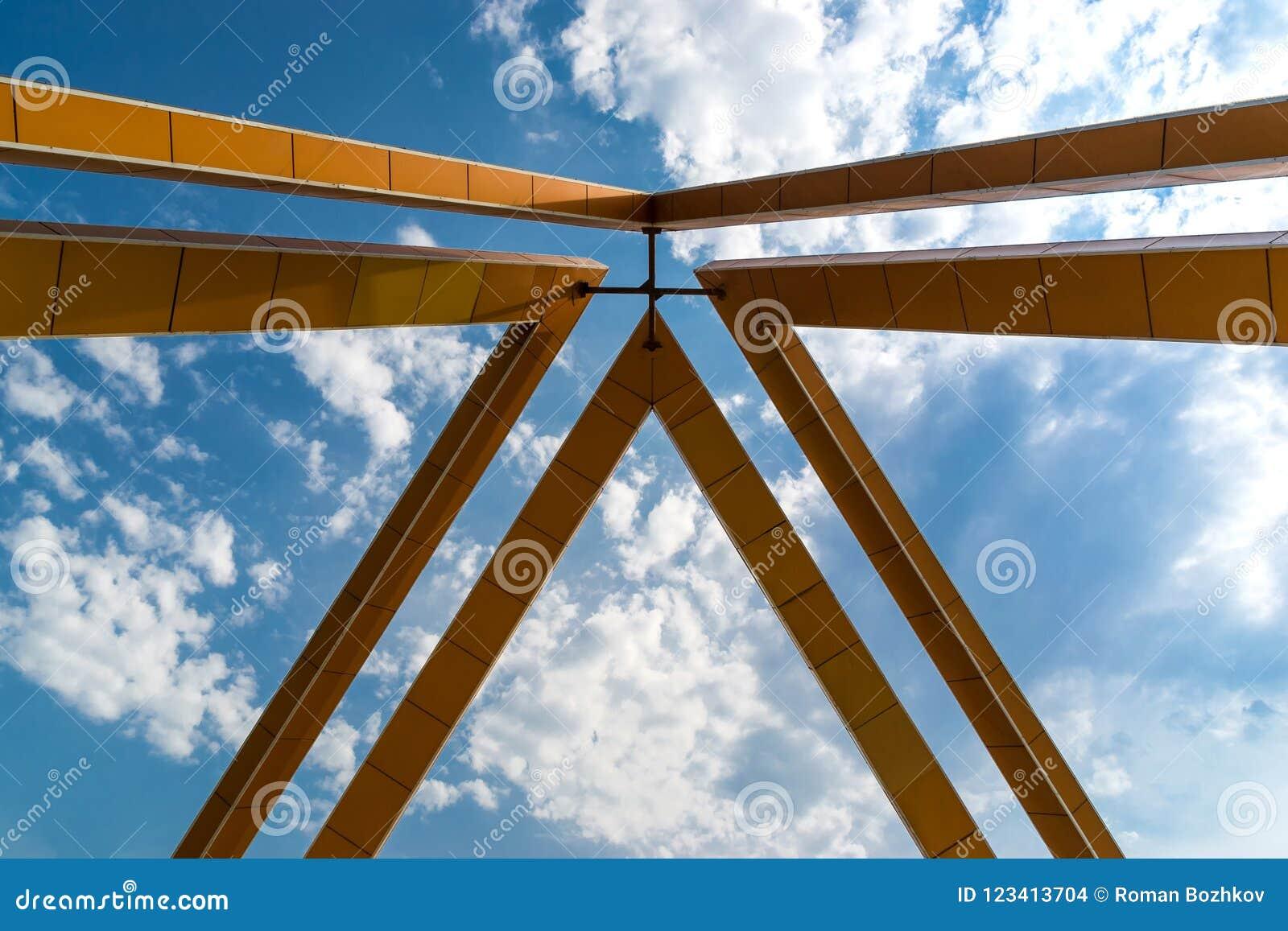 Metal framing against a blue sky.Fragment.