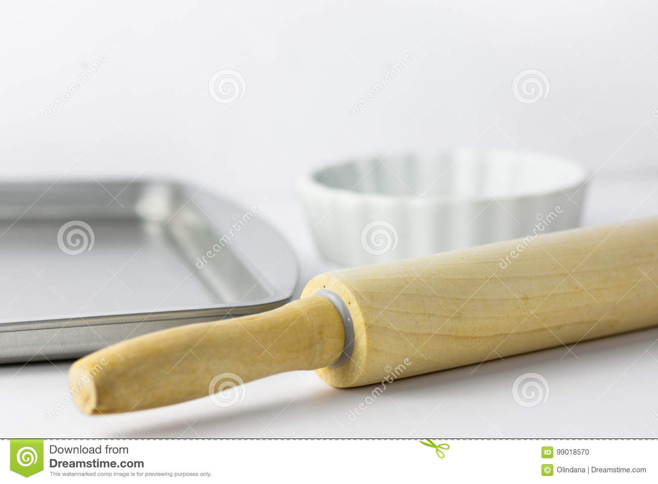 Metal Grey Baking Tray And Form Wooden Rolling Pin On White