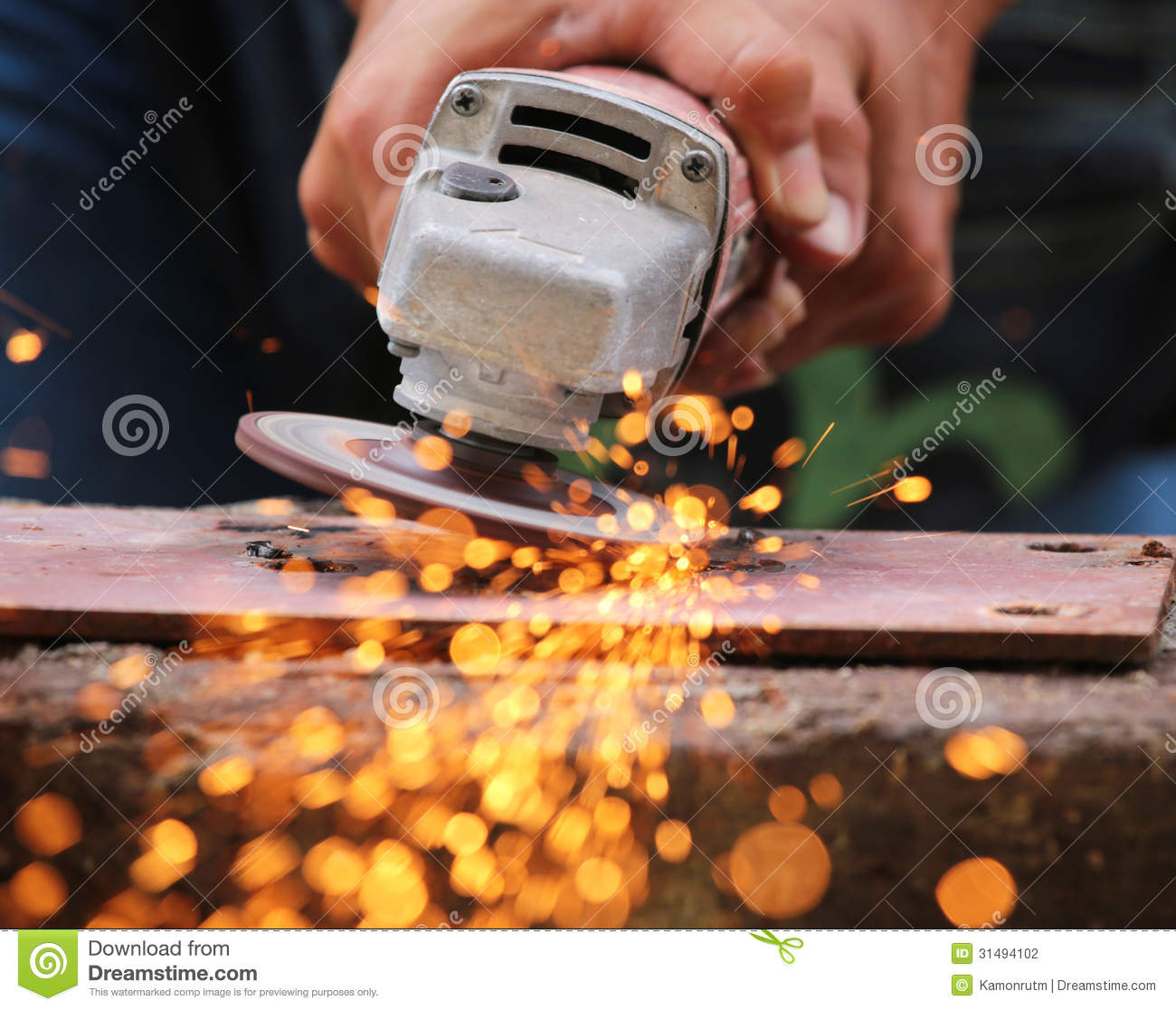 Metal grinding on steel pipe stock photography image