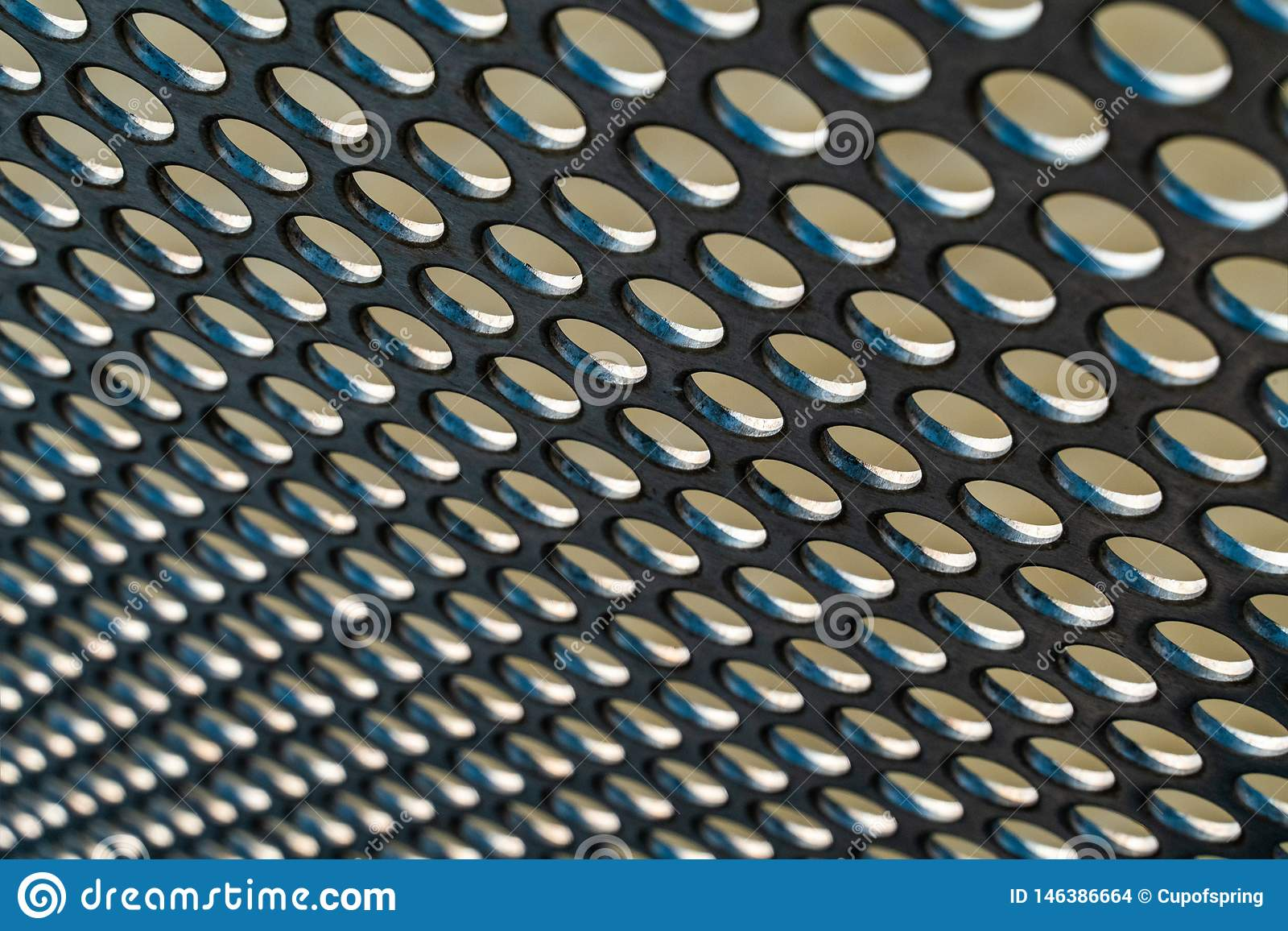 Metal hole mesh pattern with with shallow depth of focus background