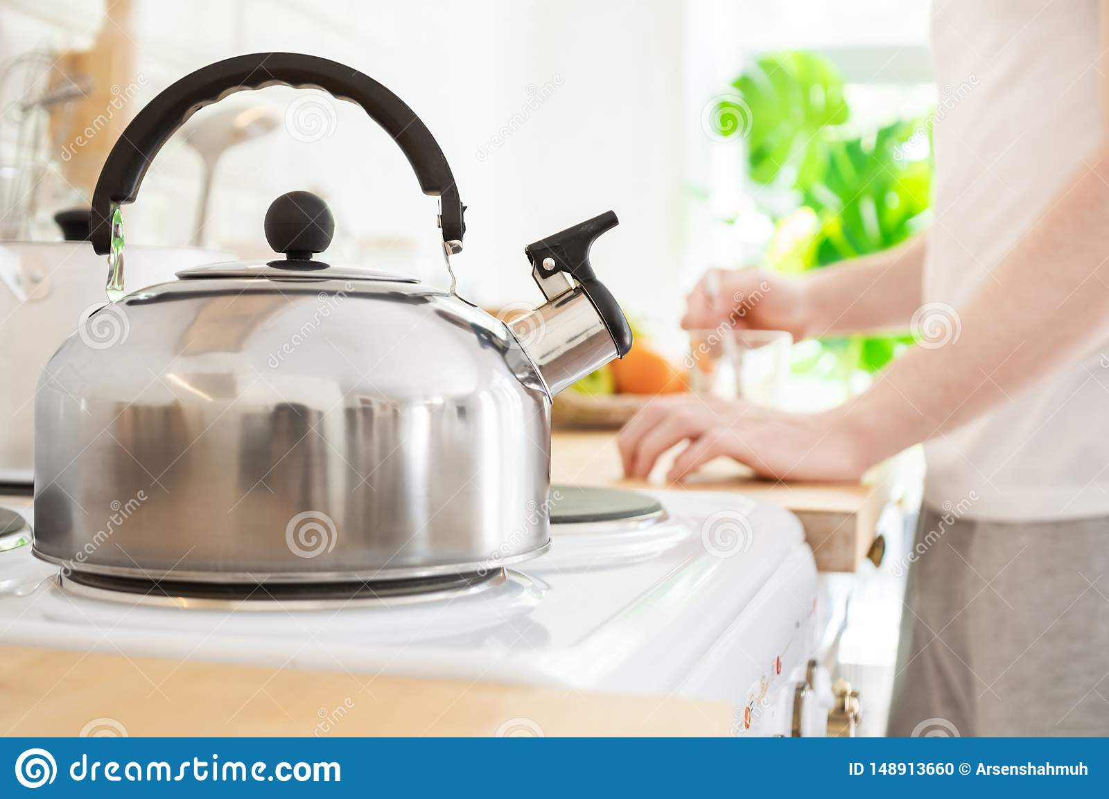 Kettle on on electric stove in the kitchen. Morning coffee or making breakfast concept