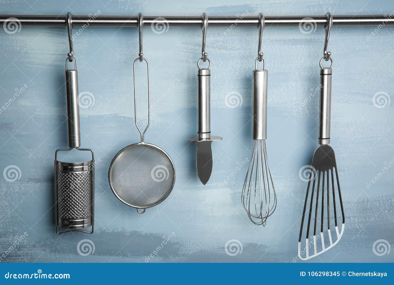 Metal Kitchen Utensils Hanging On Rack Stock Image - Image of ...