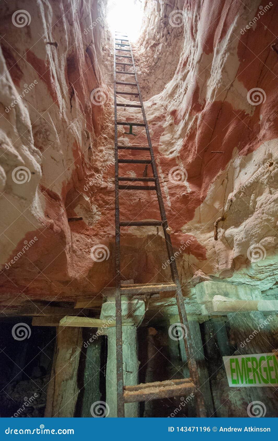 Metal ladder climb out of an opal mine