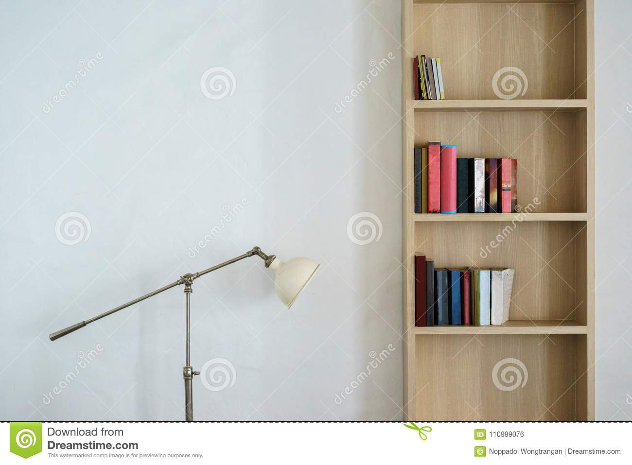 Metal Lamp Stand And Wooden Bookshelf With Books