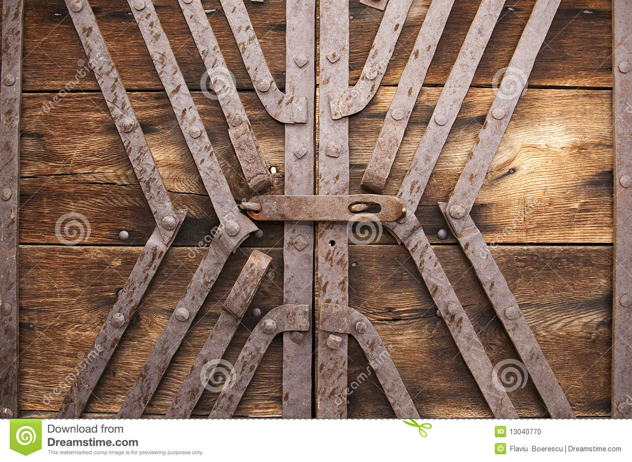 metal lock and reinforcement on wood gate stock photo image 13040770. Black Bedroom Furniture Sets. Home Design Ideas