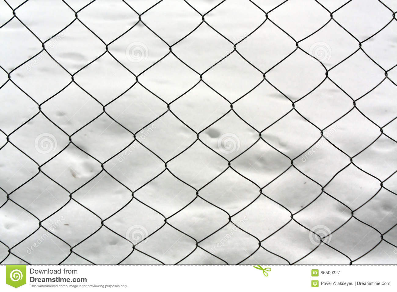 Metal Mesh Wire Fence Against Snow Pile. Stock Image - Image: 86509327