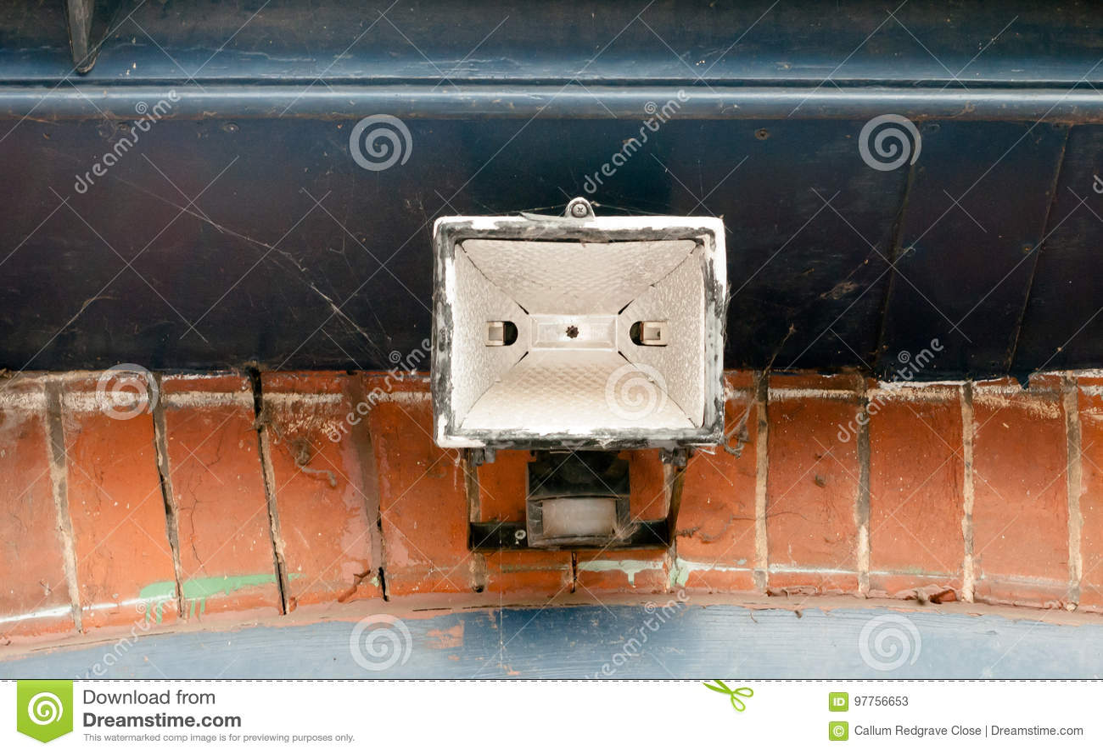 A Metal Overheard Lamp Outside Above Gate Stock Image