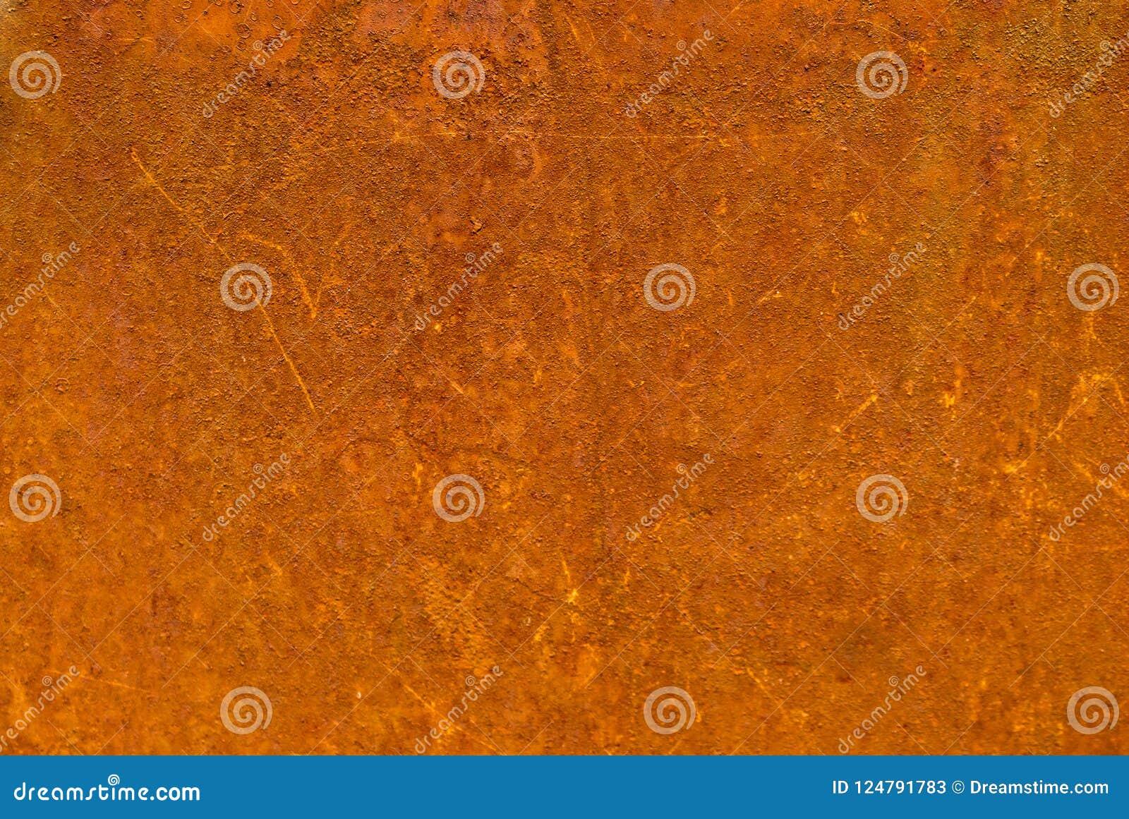 Metal oxidado com cor alaranjado-marrom da corrosão