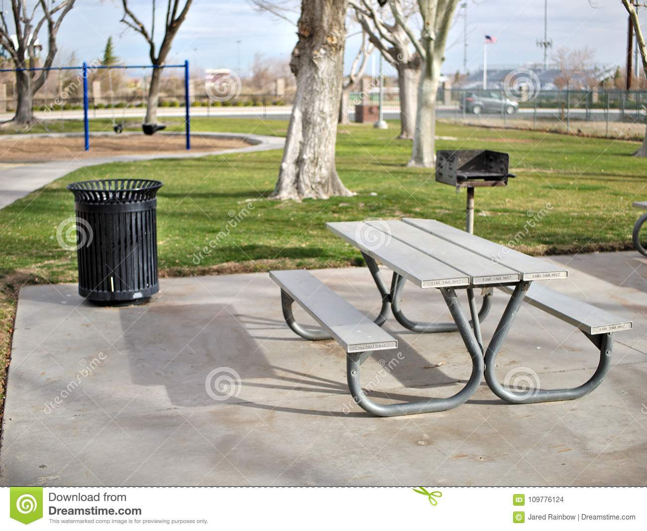 Enjoyable Metal Park Bench And Picnic Area In Park Stock Photo Caraccident5 Cool Chair Designs And Ideas Caraccident5Info