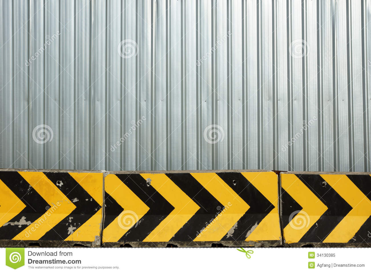 Metal plate fence and concrete barrier stock image