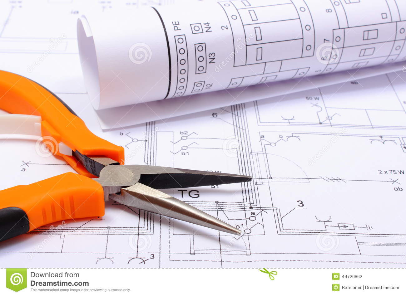 Metal Pliers And Rolled Electrical Diagram On Construction Drawing ...