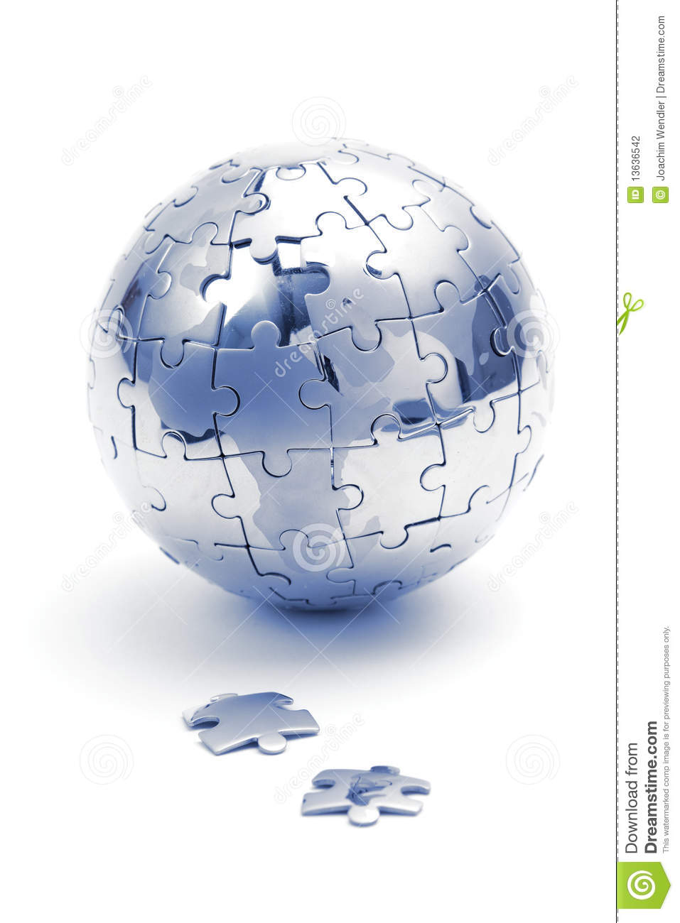 Metal puzzle globe, close-up in blue light