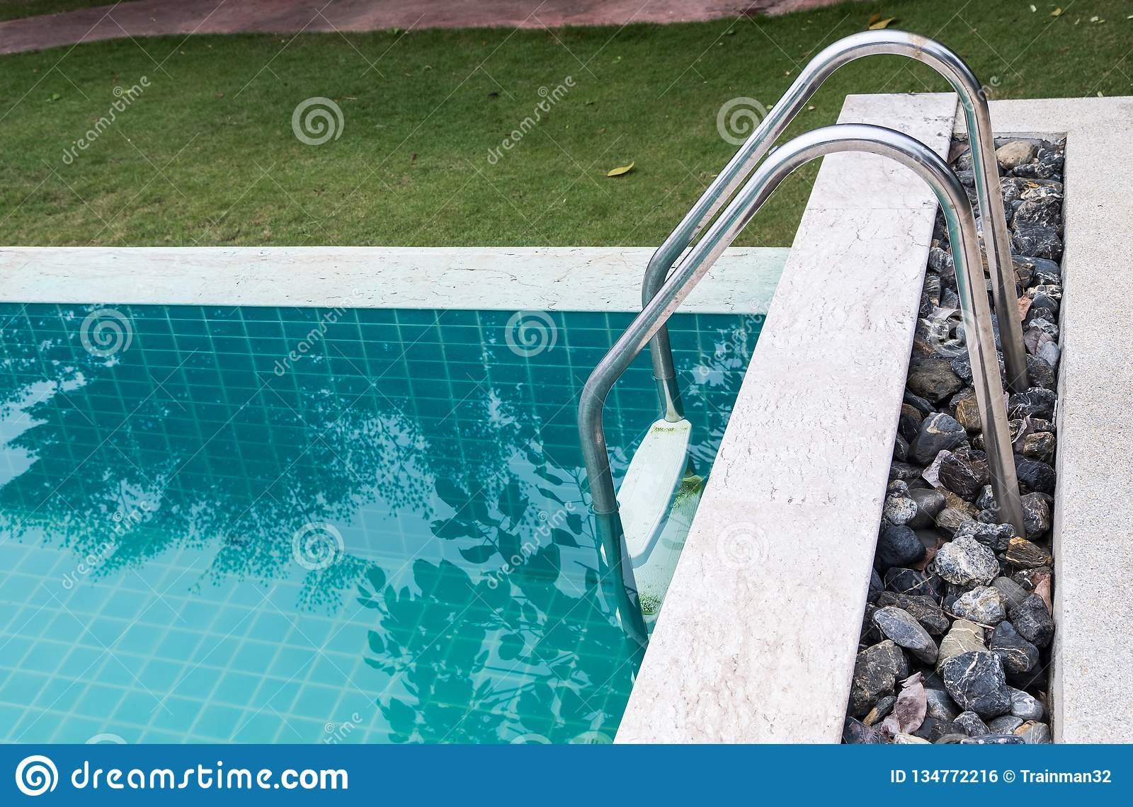 Metal Rail Of The Ladder In The Clear Swimming Pool Stock ...
