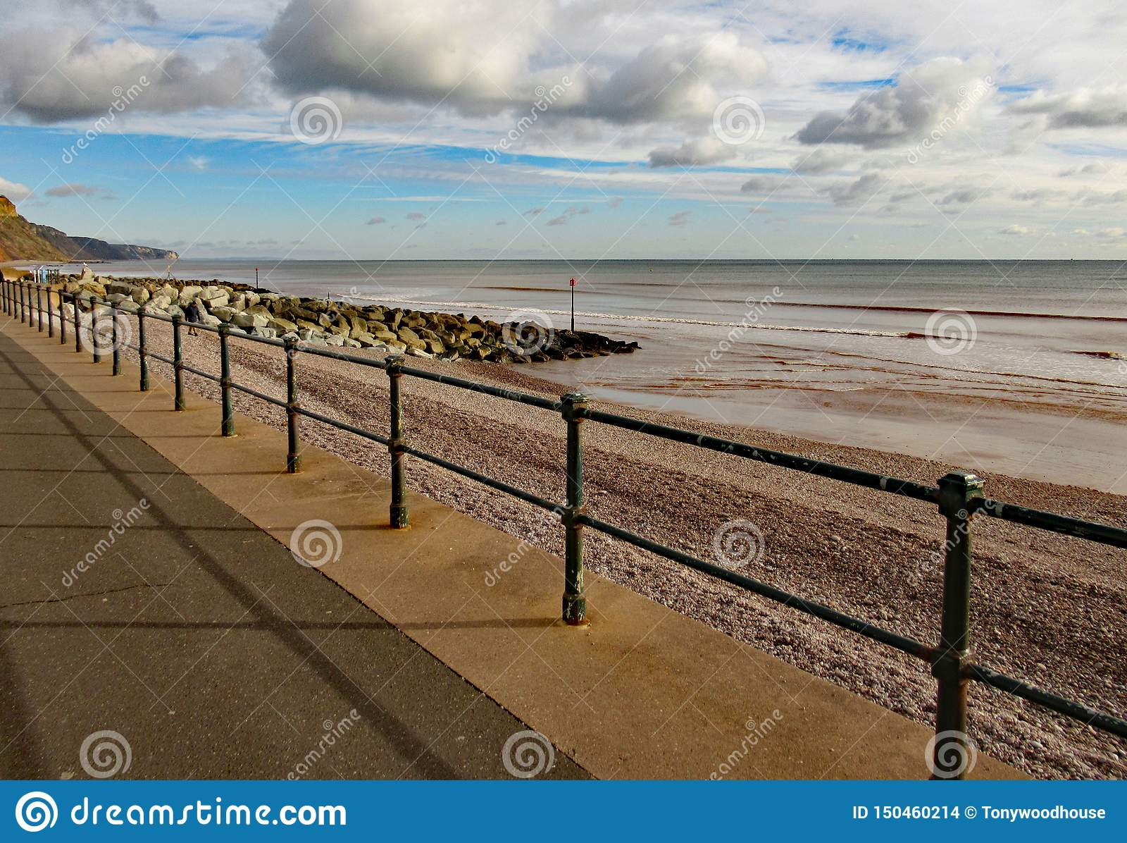 Metal railings on Sidmouth Esplanade, to stop people falling on to the pebble beach some 3 metres below