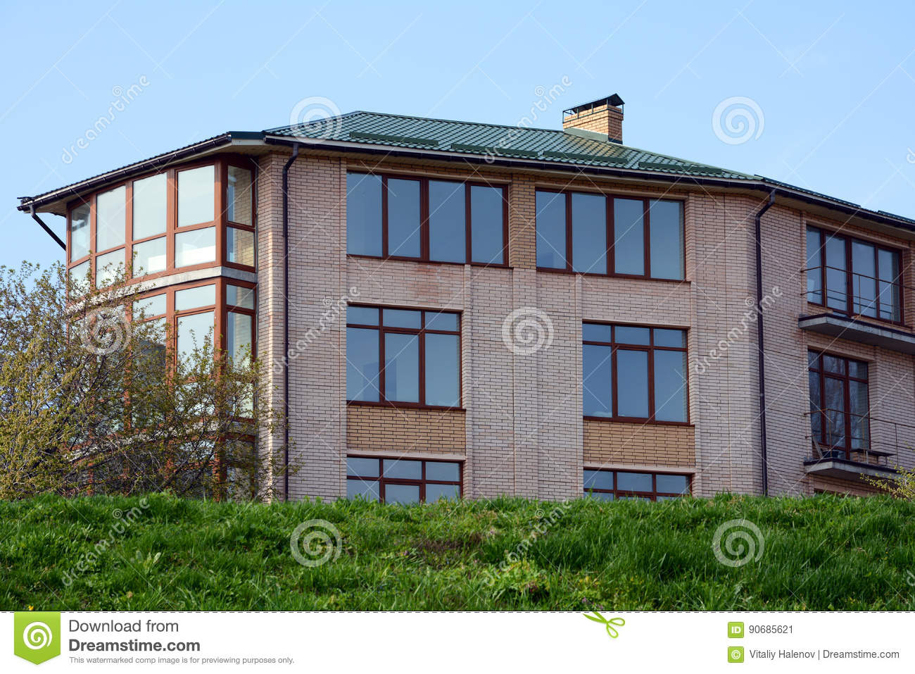 Metal Roofing Large Modern House With Large Windows And Balconies