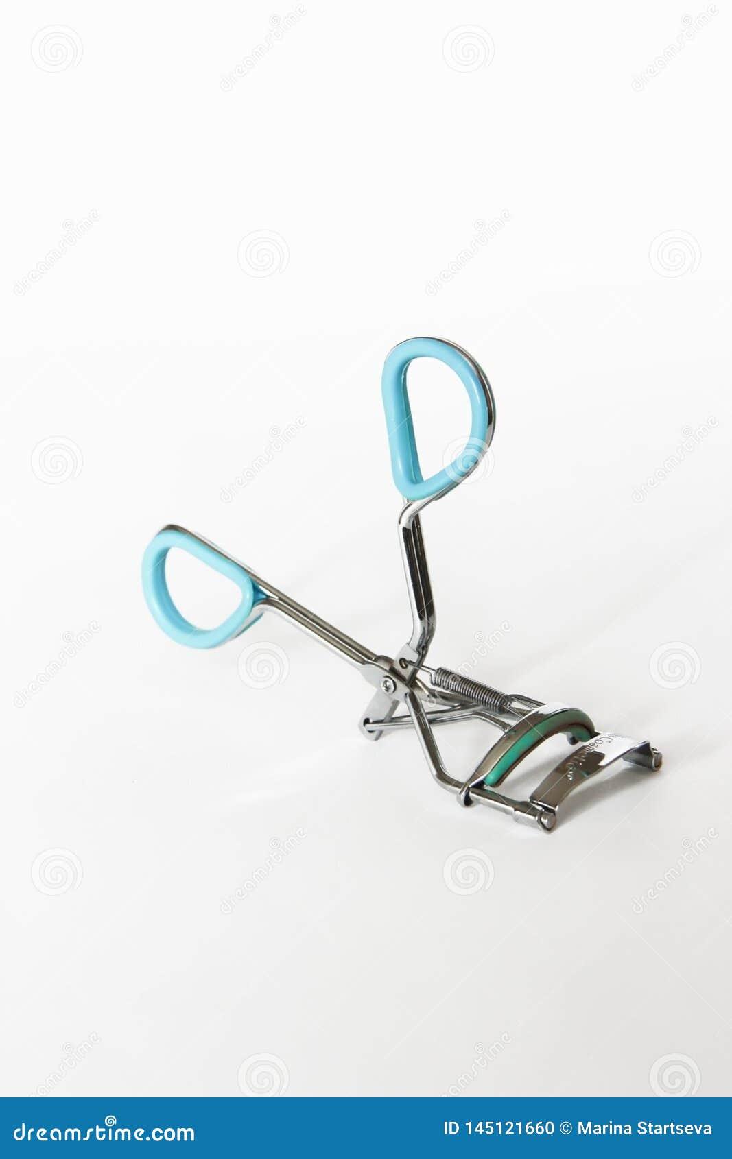 Metal rzęsy żeński curler z białym tłem
